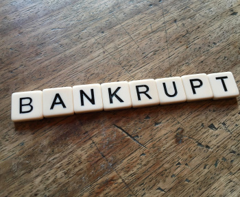 bankrupt written on the table